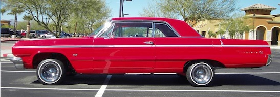 Red 64 Impala Air Ride Suspension lifted